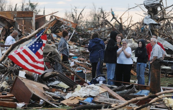 Mary Womack, in white top at the right, reacts to the news that the renter that lived in her house at 2336 Missouri, Joplin, Mo, had been found and taken to the hospital on Monday, May 23, 2011. There were at least 89 deaths and numerous casulties from the tornado that struck Joplin on Sunday.