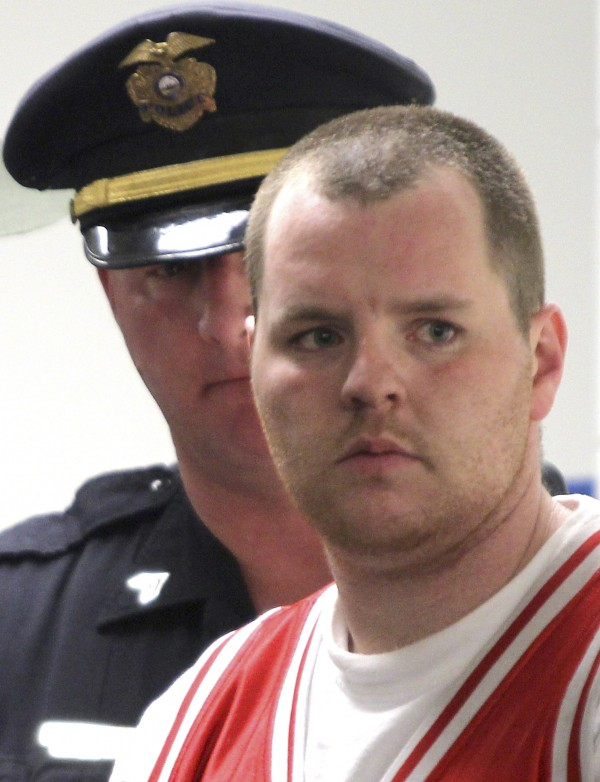Anthony Papile, 28, of Ossipee talks with his attorneys at the Ossippee District Court in Ossippee, N.H., Wednesday May 11, 2011. Papile has been charged with second degree murder in the death of 20-year-old Krista Dittmeyer, whose body was found in a Conway, N.H., pond on April 27