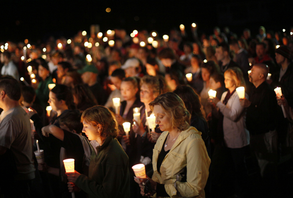 Mourners attended a candlelight memorial for Krista Dittmeyer of Portland on April 28.