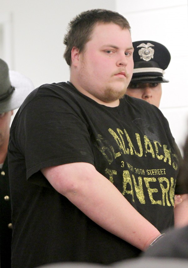 Twenty-three-year-old Trevor Ferguson of Tamworth is led into the Ossippee District Court in Ossippee, N.H., on Wednesday. Furguson is one of three men implicated in the murder of 20-year-old Krista Dittmeyer, whose body was found in a Conway pond on April 27.