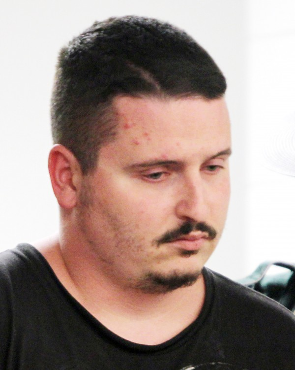 Michael Petelis, 28, of Ossipee is led into court at the Ossippee District Court House in Ossippee, N.H., on Wednesday. Petelis is implicated in the murder of 20-year-old Krista Dittmeyer, whose body was found in a Conway pond on April 27.