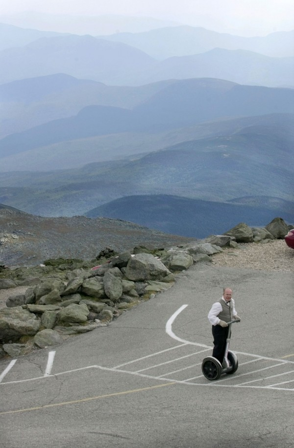 In this Aug. 27, 2003 file photo Rob Owens criss-crosses the final section of the Mount Washington Auto Road on Mounty Washington in New Hampshire on a Segway. Billed as America's oldest man-made tourists attraction, the Auto Road is celebrating its 150 anniversary this summer.