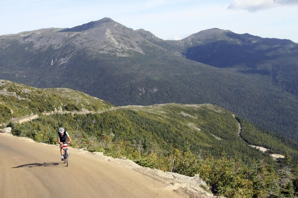 In this Aug. 21, 2010 photo Nico Toutenhoofd peddles up the Mount Washington Auto Road during the Bicycle Hillclimb. Billed as America's oldest man-made tourists attraction, the Auto Road is celebrating its 150 anniversary this summer.
