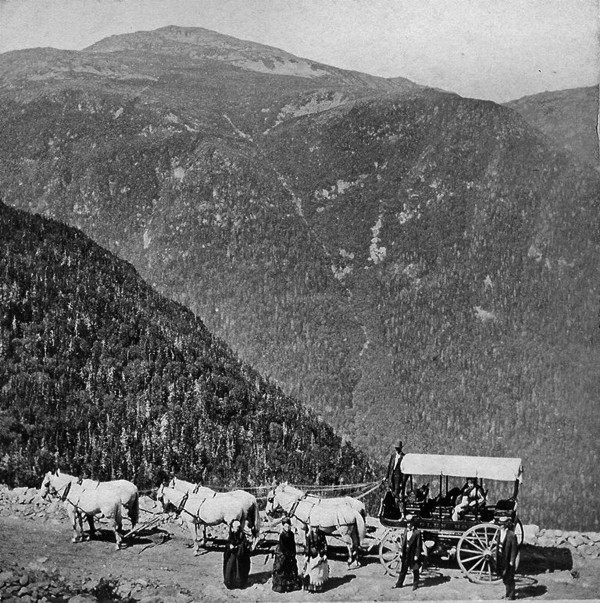 In this undated photo provided by the Mount Washington Auto Road Archives a horse drawn carriage stops for a break on the Mount Washington Auto Road. Billed as America's oldest man-made tourists attraction, the Auto Road is celebrating its 150 anniversary this summer.