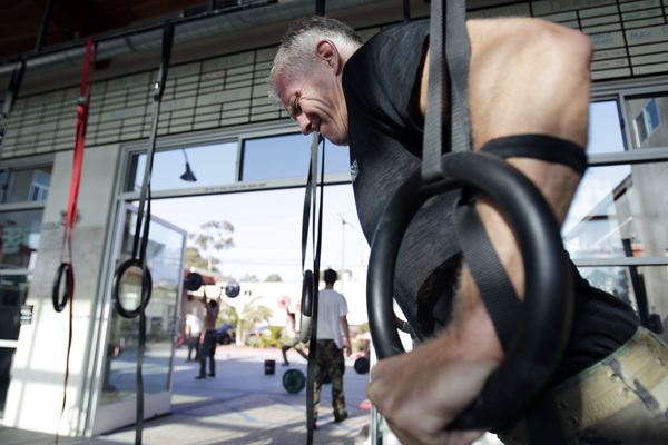 Joe Stumpf works out with rings during a workout designed to mirror a US Navy SEAL training at the SEALFIT exercise center in Encinitas, Calif. Excitement over the Navy SEAL team's takedown of Osama bin Laden is fueling interest in fitness programs run by former members of the elite force.