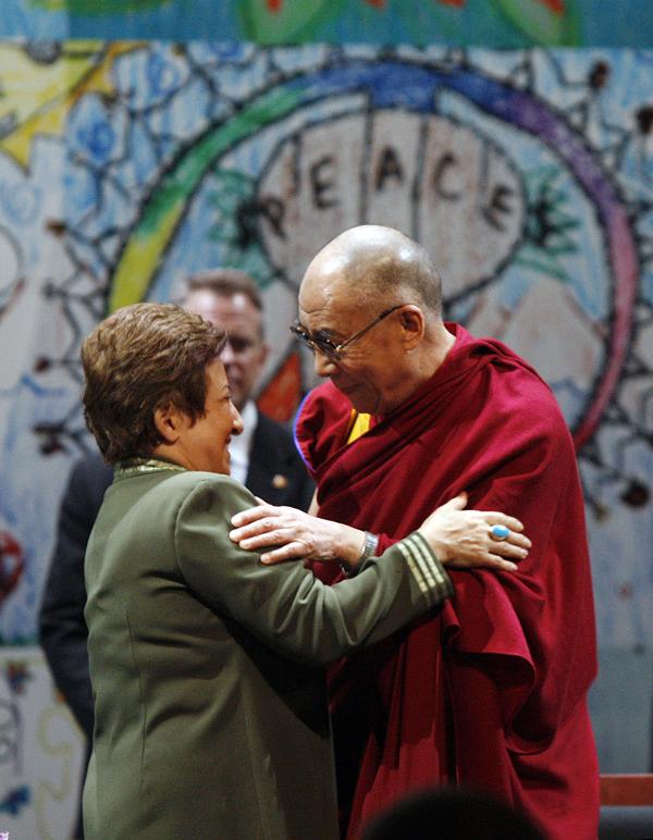 Tibetan Buddhist spiritual leader the Dalai Lama (right), greets 2003 Nobel Peace Prize winner Shirin Ebadi, of Iran at the Newark Peace Education Summit in Newark, N.J. on Friday, May 13, 2011.