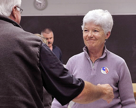 Newburgh Town Clerk Lois Libby smiles as she gets a hug of support from her brother Bob Leavitt Thursday night after resigning her position at the selectmen's meeting in the former Newburgh Elementary school, now the town office.