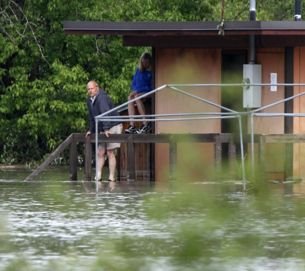 Al and Catherine Hulegaard of Andover, Minn. wait for rescue Friday, May 27, 2011 after being trapped by floodwaters overnight in Berlin, Vt. They had to stand on tables during the whole night at the Montpelier Gun Club to stay dry.