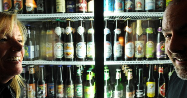 Gene Beck (right) and Ann Marie Orr with some of the 120 varieties of bottled beer and 14 different draught beer offered by the Nocturnem Drafthaus in Bangor.  Beck is the owner and he collaborated with Orr who offers catering for private functions in part of the building.