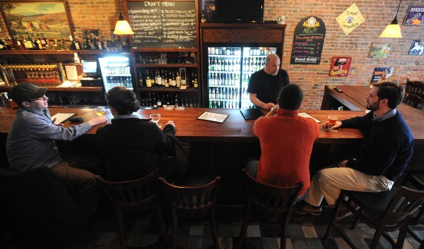 Patrons sit at the bar at the Nocturnem Drafthaus in Bangor.