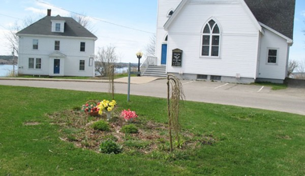 Fresh flowers were left at the Robert and Jackie Norton Memorial Garden in Lubec on Monday, May 2, 2011. The Nortons died in the Sept. 11 terrorist attacks.