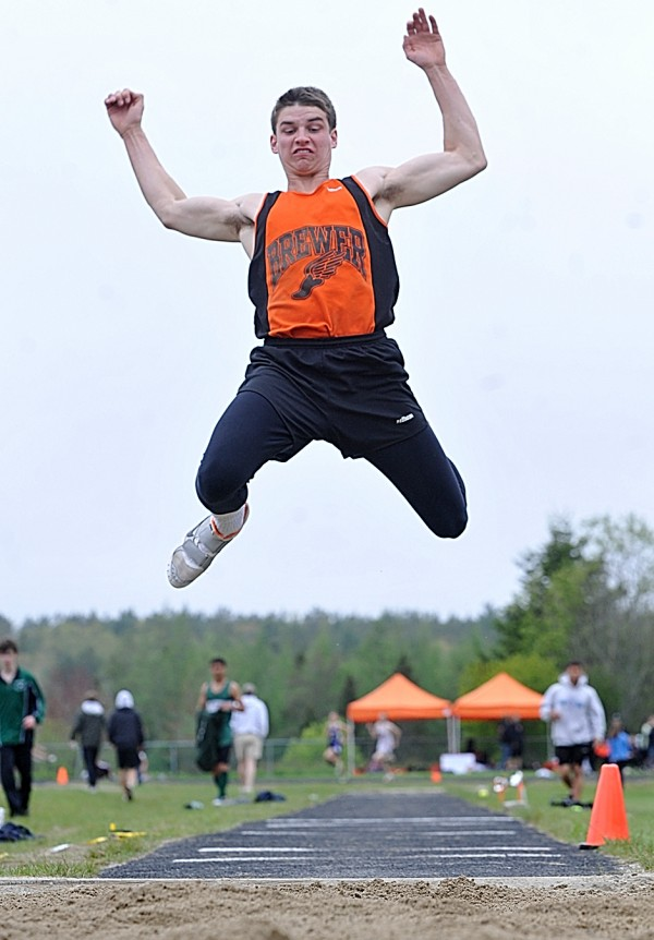 Brewer High School's Ray Bessette lifts off during the boys long jump event of the PVC Large School Championship Track and Field Meet at Mount Desert Island High School Saturday, May 28, 2011.