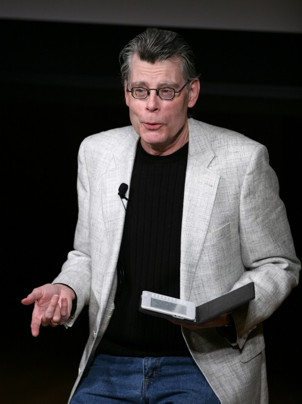 Author Stephen King reads from his book &quotUr&quot at a news conference in New York in 2009. The town of Bridgton has canceled plans for a festival in the writer's honor.