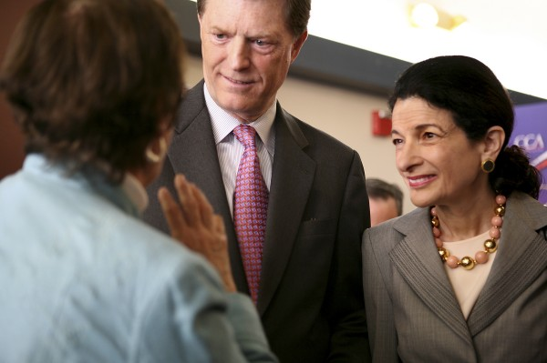 Former Maine Gov. John McKernan and his wife Sen. Olympia Snowe mingle at a luncheon for Republicans Committed to Higher Education in Minneapolis, Minn., during the Republican National Convention in September 2008. U.S. Sen. Olympia Snowe and a businessman who plans to challenge her in next year's primary are trading barbs over Snowe's husband's role at a publicly traded education company. Snowe's challenger, Scott D'Amboise, on Tuesday called on Snowe to resign from the Senate after a whistleblower lawsuit accused Pittsburgh-based Education Management Corp. of defrauding the government of taxpayer-funded financial aid by illegally compensating its recruiters on a per-person basis. Snowe's husband, McKernan. is Education Management's board chairman.