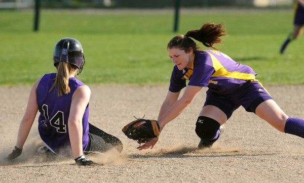 Bucksport High School's Shelby Redman (right) is late with the tag as John Bapst's Katie Hammond slides to second base in Bangor Monday.