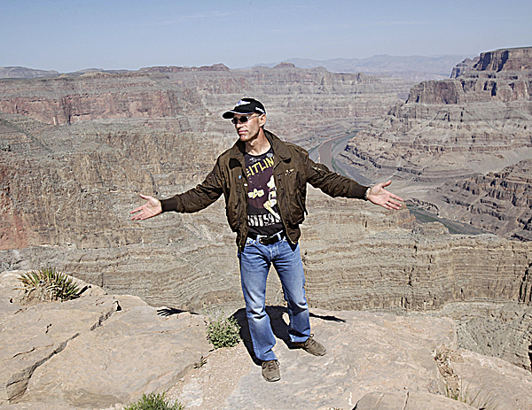 Swiss adventurer Yves Rossy stands on the ledge of the Grand Canyon on Guano Point on the Hualapai Indian Reservation Friday.