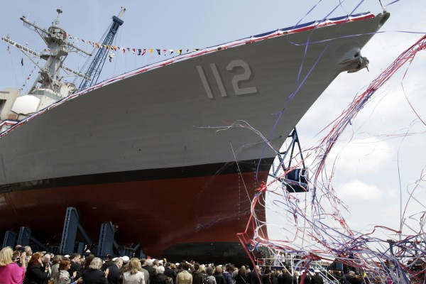 Hundreds watch during the ship christening ceremony at the Bath Iron Works shipyard honoring Medal of Honor recipient Navy Lt.  Michael Murphy,in Bath, Maine on Saturday, May 7, 2011. The destroyer under construction at Maine's Bath Iron Works bears the name of Lt. Michael Murphy, who was killed in a firefight on June 28, 2005, in eastern Afghanistan. The ceremony was held Saturday on what would've been Murphy's 35th birthday and nearly a week after Navy SEALs killed Osama bin Laden in Pakistan.