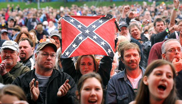 Fans react as members of the band Lynyrd Skynyrd appear on the stage during a concert at the Bangor Waterfront Thursday evening.