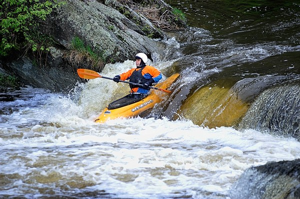 David Smallwood of Holden takes advantage of the recent rainfall, playboating in his kayak at the Flour Mill Dam section of the Kenduskeag Stream In Bangor.