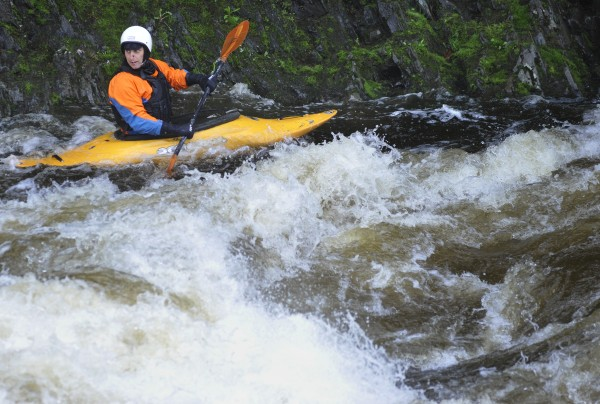 David Smallwood of Holden takes advantage of an eddy for a quick break while playboating in his kayak at the Flour Mill Dam section of the Kenduskeag Stream In Bangor.