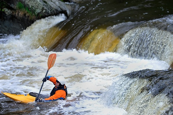 During his lunch break Tuesday, May17,  David Smallwood of Holden takes advantage of the recent rainfall, playboating in his kayak at the Flour Mill Dam section of the Kenduskeag Stream In Bangor.