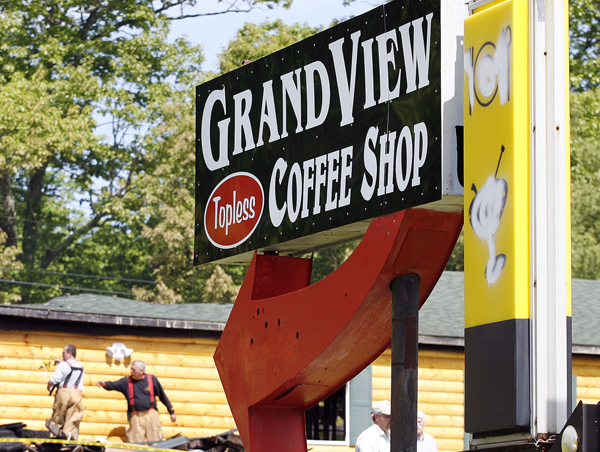 Firefighters look over the ruins of the Grand View Topless Coffee Shop in June 2009 in Vassalboro. The coffee shop went up in flames just hours after the owner went to the town's planning board to discuss expanding the business.