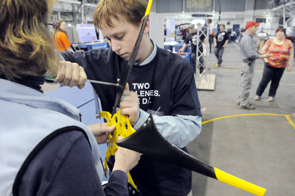 With the help of his mother Shelly West, left, Sumner Memorial High School freshman Dylan Alley, 14 of Sullivan secures his turbine blades before their wind test at the Maine Wind Blade and Maine Windstorm Challenges at the University of Maine in Orono Friday. 60 teams comprising 30 high school, 350 students and 30 teachers from across the state took part in Friday's competition.