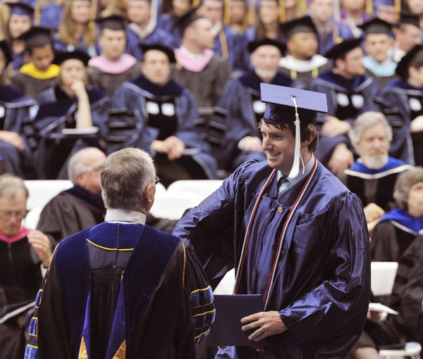 Brian Shelly receives his diploma from President Robert Kennedy at the 209th Comencement in Orono, Saturday May 7, 2011.