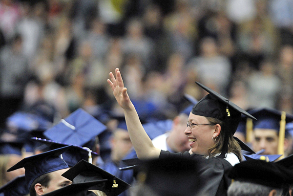 Paige Mitchell waves across the graduate covered floor of the Alfond Arena to well-wishers before the start of the 209th Commencement of the University of Maine in May 2011.