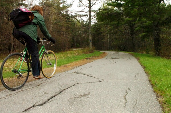 A cyclist rides on a section of the University of Maine bicycle paths on Tuesday. Starting on May 31, there will be phased closures on various stretches of the path to allow for major reconstruction of the 34-year-old path. The repairs will take approximately 11 weeks to complete.