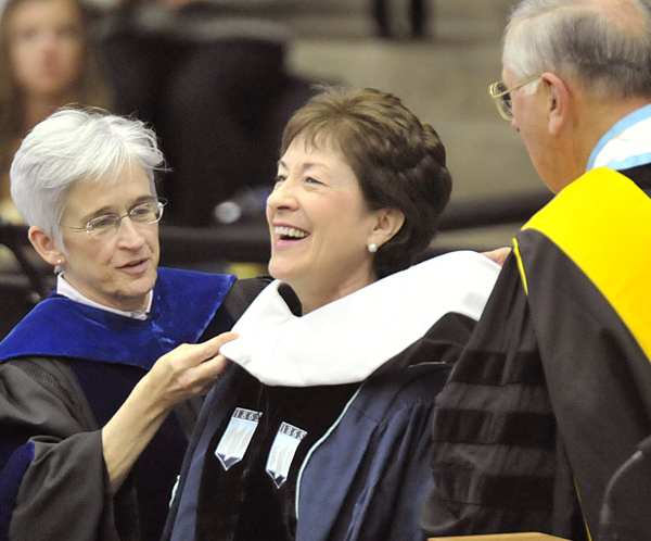 US Senator Susan Collins receives an honorary Doctor of Humane Letters from Provost Susan Hunter (left), and Trustee William Johnson at the 209th Commencement morning ceremony in Orono Saturday.