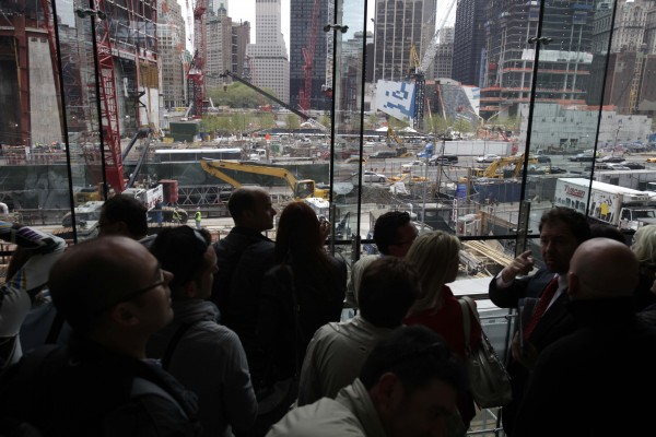 A crowd of people look over ground zero in New York, Monday, May 2, 2011.  Osama bin Laden, the face of global terrorism and architect of the Sept. 11, 2001, attacks, was killed in a firefight with elite American forces in Pakistan on Monday, May 2, 2011, then quickly buried at sea.