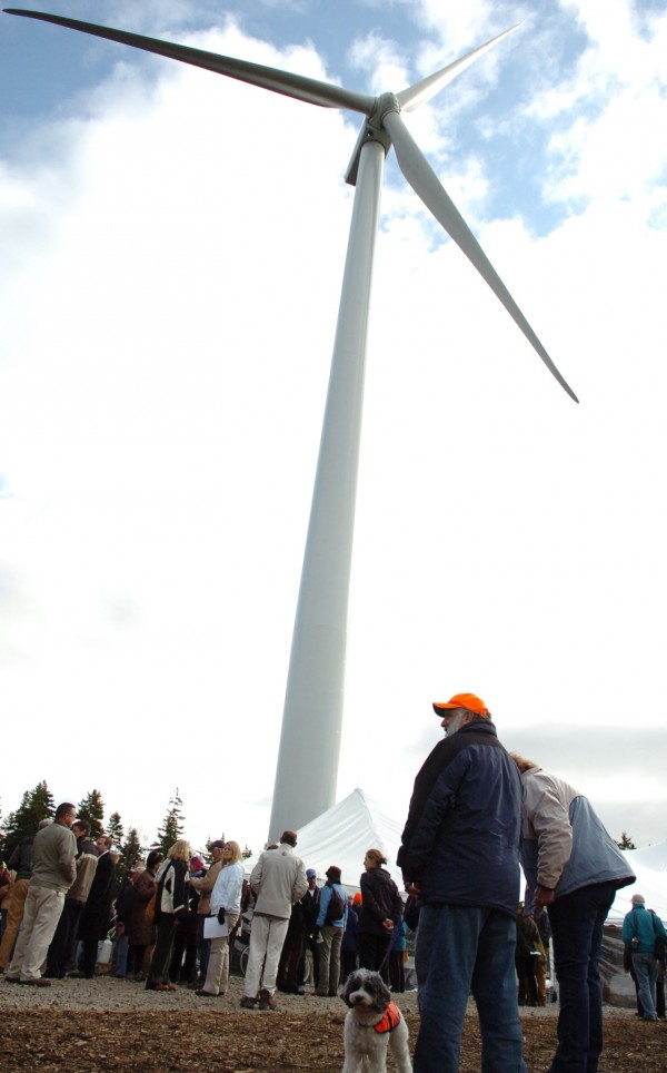 "Island residents including Patrick Trainor (lower right) and his dog Kaiko gather for a ribbon-cutting ceremony for the three wind turbines of Fox Islands Wind on Vinalhaven on Tuesday, Nov. 17, 2009. ""It's pretty terrific,"" said Trainor of the trio of turbines, which are expected to generate enough electricity to power both Vinalhaven and North Haven islands. The venture is the largest community-owned wind project on the East Coast."