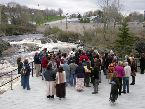 Native people sing prayers beside the turbulent Bad Little Falls before departing from Machias May 7 on the eartern portion of the 2011 Mother Earth Water Walk to call attention to the need for clean water.