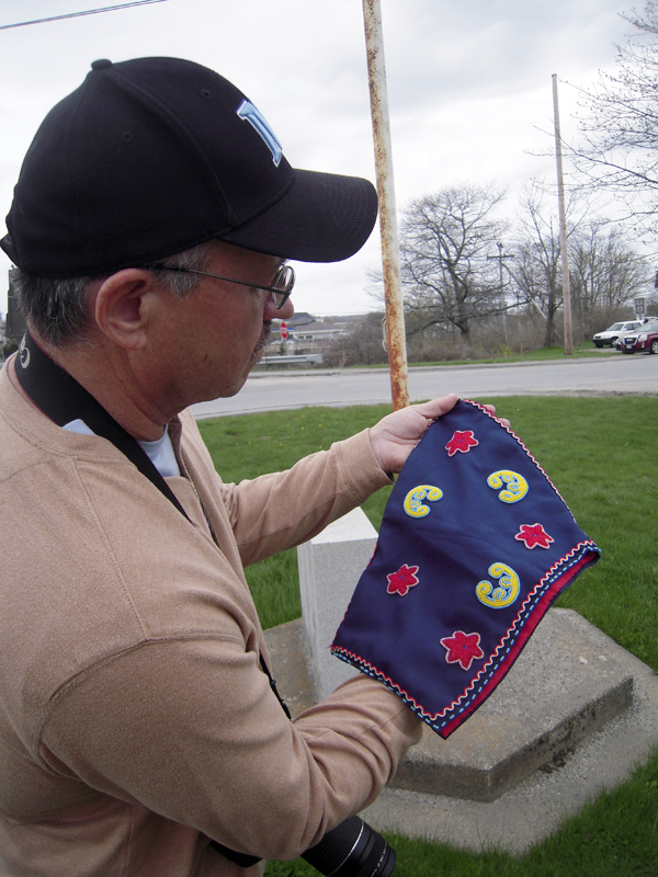 Donald Soctomah explains that the traditional beaded peaked woman's hat from the Houlton Band of Maliseets has been passed down in the family of David Slagger and may be 100 years old.
