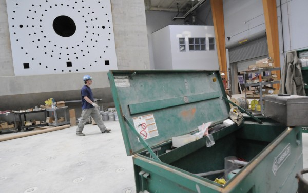 John Reynolds, an electrician with Westbrook-based E.S. Bolous Company, is dwarfed by the 6.5 million pound, 52 foot high, windblade mounting stand at the soon-to-be-completed Advanced Nanocomposites in Renewable Energy Laboratory at the University of Maine in Orono Friday, May 13, 2011. Once completed later this summer, the laboratory will boast the longest wind testing floor in the U.S.