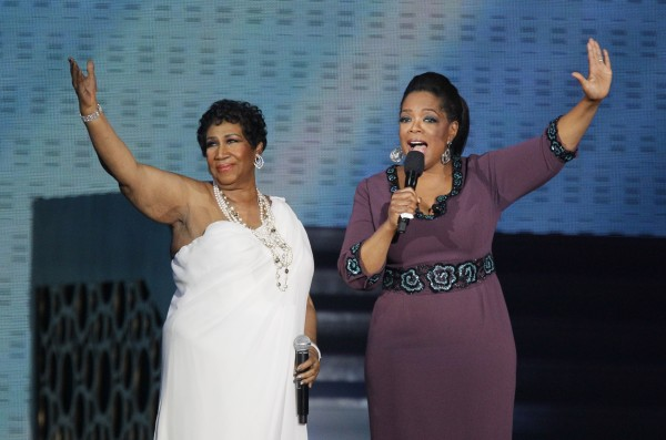 "Aretha Franklin and Oprah Winfrey acknowledge fans during a star-studded double-taping of ""Surprise Oprah! A Farewell Spectacular,"" Tuesday, May 17, 2011, in Chicago. ""The Oprah Winfrey Show"" is ending its run May 25, after 25 years, and millions of her fans around the globe are waiting to see how she will close out a show that spawned a media empire."