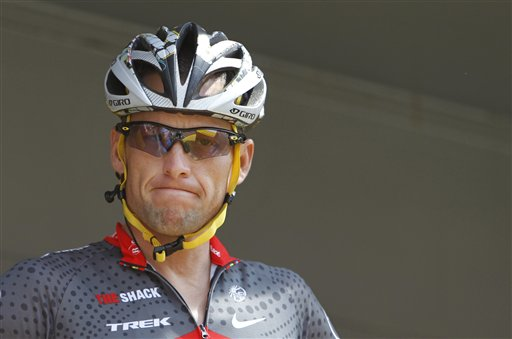 Lance Armstrong grimaces prior to the start of  the third stage of the 2010 Tour de France cycling race in Wanze, Belgium.
