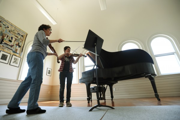 Music instructor Gilda Joffee, left, works with student Emma Walsh at the Bay Chamber Music School in Rockport on Friday, May 13, 2011.