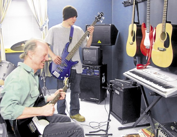 Volunteer music teacher Bruce Boege of Northport and student Dan Arnold, 19, of Searsport jam during a lesson at BCOPE, the Belfast area's alternative high school. A grant the school recently received has allowed it to purchase more instruments and improve the program.