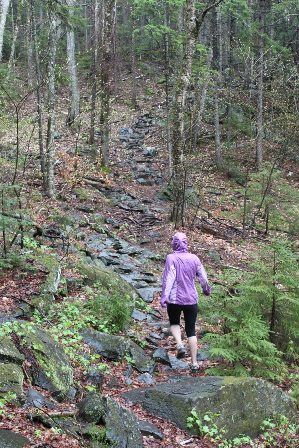 BDN reporter Aislinn Sarnacki sets out on the .8-mile trail to the visitor center at the base of Borestone Mountain in Elliotsville Township on May 14.