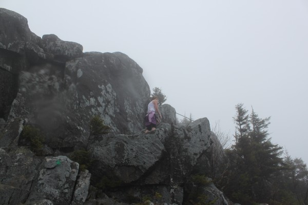 BDN Reporter Aislinn Sarnacki carefully scrambles up the exposed rock and metal rungs on the trail leading to the summit of Borestone Mountain on May 14.