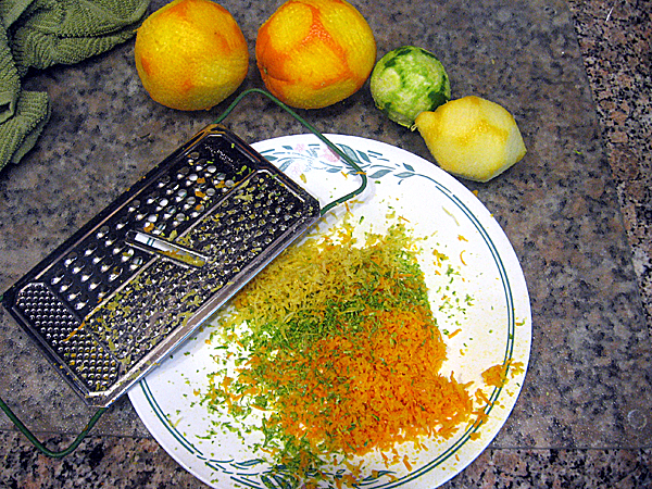Grating orange, lemon and lime peels with a cheese grater is a way to incorporate citrus flavor into a home-brew.