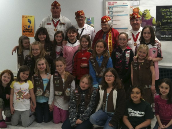 Brownie Troop 350 in Bangor worked with the Marine Corps League learning about female Marines in World War II, the American Flag and visiting the Maine Veterans Home in Bangor, where the girls delivered pots of pansies to each of the resident units. Pictured are (back row, from left) William Jones, commandant, Marine Corps League; Reginald Early Sr., vice commandant, Frances Mitchell, Marine Corps veteran of World War II, author and speaker; Michael Beagan, Veterans' Affairs officer; (middle row) Madison Burnes, Callie Bernard, Sarah Keene, Kaylee Perkins, Claire Pellegrino, Mackenzie Lambert, Emily Doyle, Sarah McNeil, Hannah Dunn and Kelly Pellegrino; (front row) Shelby Larlee, Aimee Ouellette, Madison Clay, Lily Mitchell, Abby Cadorette, Brianna Adams, Alia AbdelQader and Olivia Herschell.