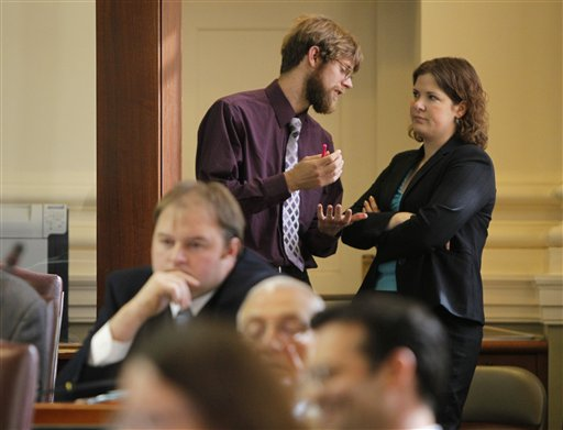 State Rep. Adam Goode, D-Bangor, and House Democratic leader Emily Cain, D-Orono, speak in the rear of the House during a debate on the  Republican-backed LD 1333 on Thursday, May 12, 2011, at the State House in Augusta, Maine. The Senate is expected to take up the matter on Monday.