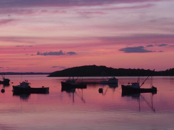 The sun sets at Lubec Harbor on Cobscook Bay in June 2010. Shops, restaurants and other new businesses have been revitalizing Lubec over the past five years.