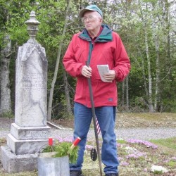 John Dudley of the Alexander-Crawford Historical Society discusses the lives of Civil War veterans buried in the town cemetery during a Decoration Day walk Saturday at the cemetery. At his feet are cedar boughs, a traditional Decoration Day sentiment that dates back to the Civil War and is a forerunner of Memorial Day.