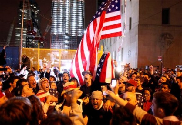 With the new One World Trade Center building in the background, second left, a large, jubilant crowd reacts to the news of Osama bin Laden's death at the corner of Church and Vesey Streets, adjacent to ground zero, during the early morning hours of Monday, May 2.