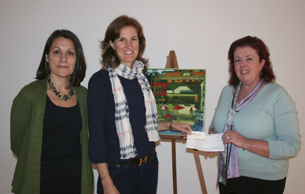 Machias Savings Bank assistant vice president Judith Brogden (right) presents a check for sponsorship of CMCA's 34thAnnual Benefit Art Auction to CMCA trustee Heather Hearst (middle) and director Suzette McAvoy. The painting pictured is by artist Mary Bourke of Lincolnville and is one of the auction pieces.