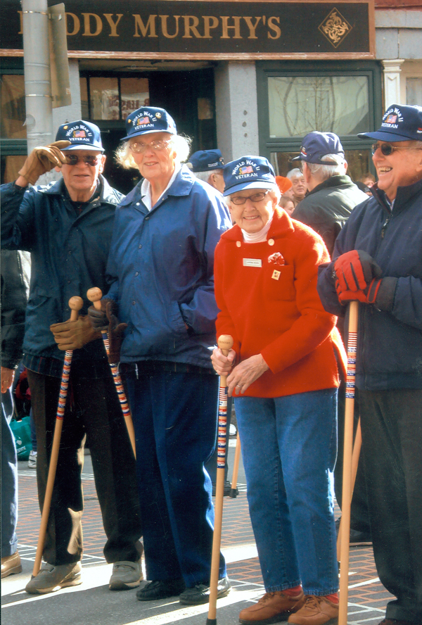 Guy (from left) and Nancy Ellms of Dexter, shown marching in the 2008 Veterans Day Parade in Bangor, will lead the World War II veterans in Monday's Memorial Day Parade beginning at 10:30 a.m. at State and Exchange streets in Bangor.